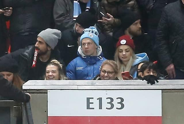 City's Oleksandr Zinchenko took his place among the away fans at Old Trafford (Martin Rickett/PA)