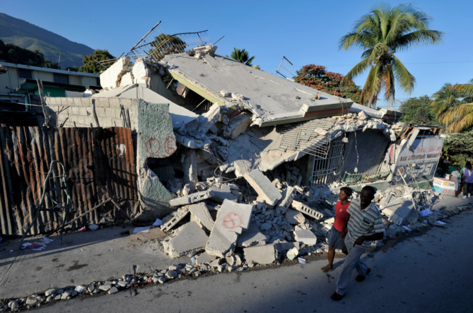Collapsed buildings in Port-aux-Prince, Haiti's capital city, show the extreme damage from the 2010 Haiti earthquake that left 1.5 million Haitians homeless