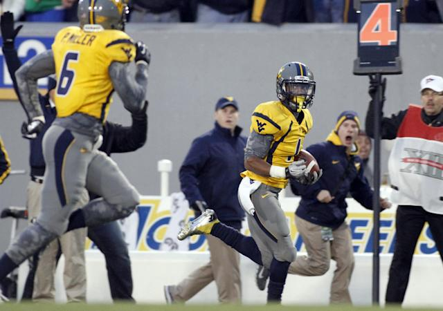 MORGANTOWN, WV - NOVEMBER 03: Tavon Austin #1 of the West Virginia Mountaineers runs back a punt for a touchdown in the second half of the game against the TCU Horned Frogs during the game on November 3, 2012 at Mountaineer Field in Morgantown, West Virginia. TCU defeated WVU in two overtimes 39-38. (Photo by Justin K. Aller/Getty Images)