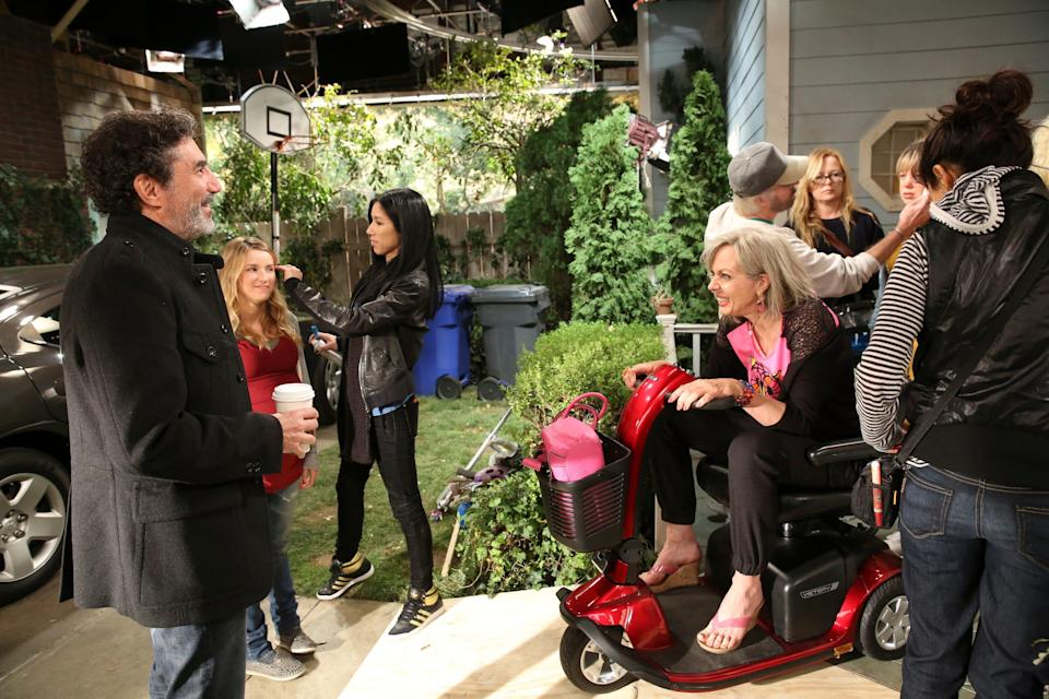 """""""Mom"""" executive producer Chuck Lorre, left, talks to star Allison Janney, sitting, during a break in the filming of a Season 1 episode of the critically acclaimed CBS sitcom."""