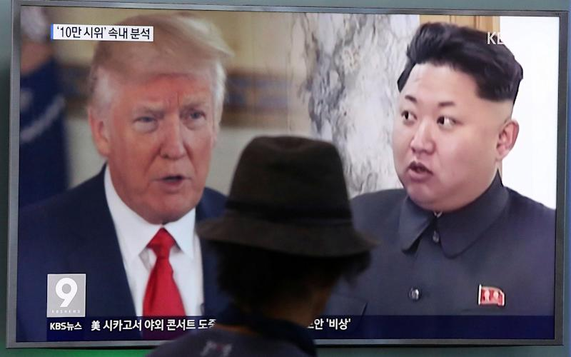 In this Aug. 10, 2017, file photo, a man watches a television screen showing U.S. President Donald Trump, left, and North Korean leader Kim Jong Un during a news programme at the Seoul Train Station in Seoul, South Korea - AP