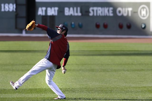 Boston Red Sox relief pitcher Koji Uehara, of Japan, throws to teammate Junichi Tazawa during a baseball workout at Fenway Park, Friday, Oct. 18, 2013, in Boston. The Red Sox are scheduled to host the Detroit Tigers in Game 6 of the American League baseball championship series on Saturday. (AP Photo/Charles Krupa)