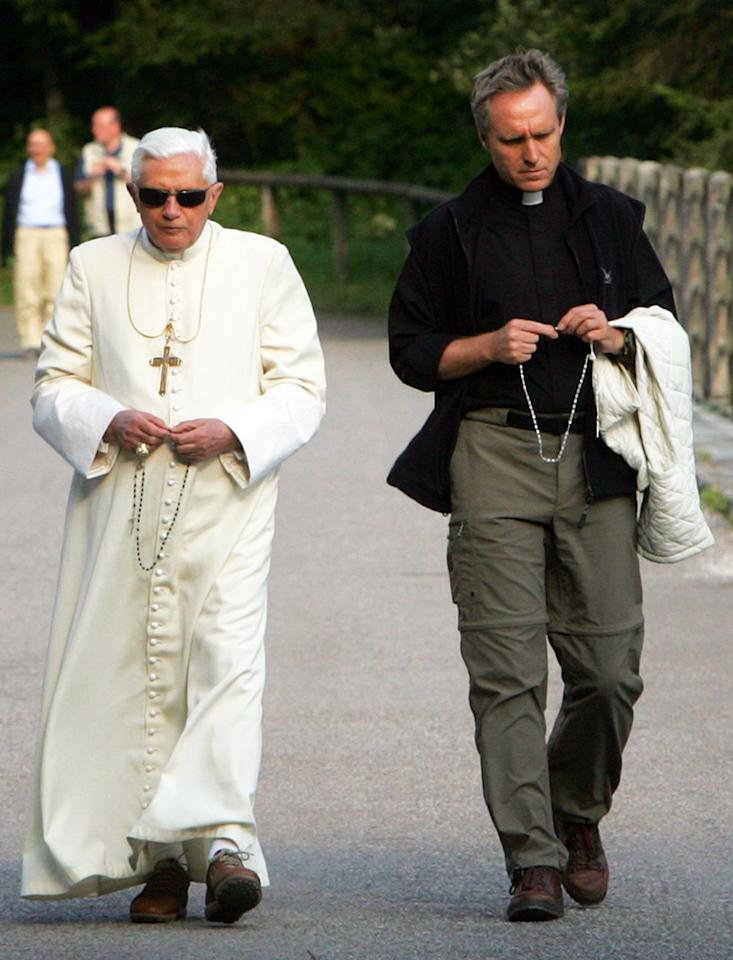 Pope Benedict XVI flanked by his secretary Georg Ganswein (R) and Angelo Gugel during his summer retreat in the Italian Alps where he will spend his summer holiday on July 23, 2007 in Domegge di Cadore, Italy. (Photo by Alessia Giuliani-Pool/Getty Images)
