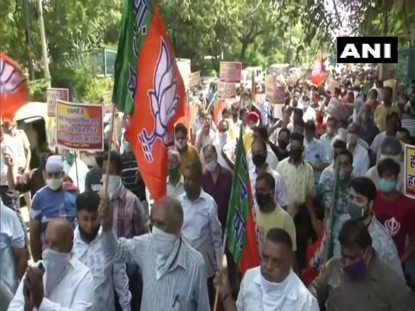 BJP workers protest in national capital. (Photo/ANI)