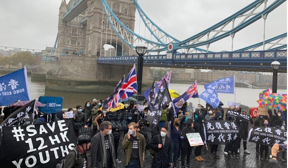 Demonstrators gather in front of London's Tower Bridge in support of 12 Hong Kong fugitives now detained in mainland China. Photo: Eileen Chang/Twitter