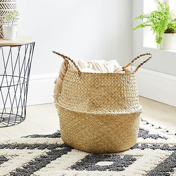 """<strong>Jacqueline Kilikita, Beauty Editor</strong><br><br>With spring on the way, I need somewhere to roll away all my cosy blankets. They need to be accessible, though, because we all know that British weather is temperamental. This storage basket is perfect and doesn't cost a fortune like some others.<br><br><strong>Dunelm</strong> Natural Belly Storage Basket, $, available at <a href=""""https://www.dunelm.com/product/natural-belly-storage-basket-1000155992?defaultSkuId=30667487"""" rel=""""nofollow noopener"""" target=""""_blank"""" data-ylk=""""slk:Dunelm"""" class=""""link rapid-noclick-resp"""">Dunelm</a>"""