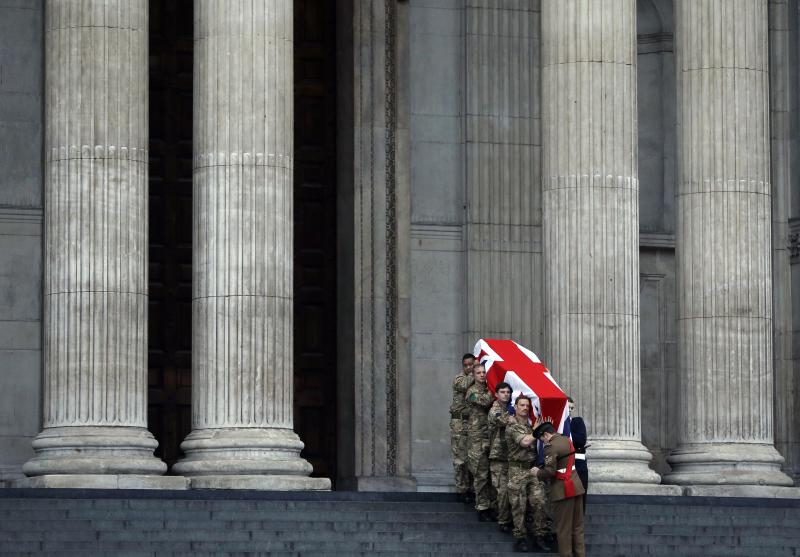 """British forces' officers carry a Union Jack-draped coffin outside St Paul's Cathedral in central London early Monday, April 15, 2013 during the rehearsal for the upcoming funeral of former British Prime Minister Margaret Thatcher. Thatcher, the combative """"Iron Lady"""" who infuriated European allies and transformed her country by a ruthless dedication to free markets in 11 bruising years as prime minister, died Monday, April 8, 2013. She was 87 and the funeral will take place Wednesday, April 17, 2013. (AP Photo/Lefteris Pitarakis)"""