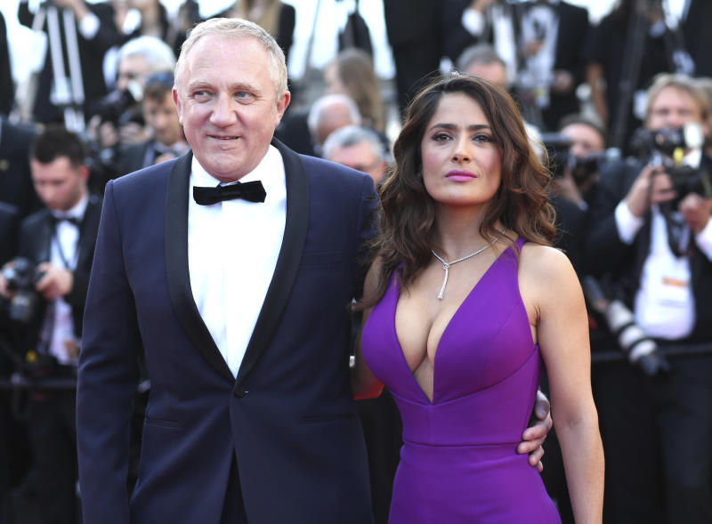 "FILE - In this Sunday, May 17, 2015 file photo Francois-Henri Pinault and Salma Hayek pose for photographers upon arrival for the screening of the film Carol at the 68th international film festival, Cannes, southern France. Businessman Francois-Henri Pinault and his billionaire father Francois Pinault said they were immediately giving 100 million euros from their company, Artemis, to help finance repairs to fire damaged Notre Dame cathedral. A statement from Francois-Henri Pinault said ""this tragedy impacts all French people"" and ""everyone wants to restore life as quickly as possible to this jewel of our heritage."" (AP Photo/Thibault Camus, File)"