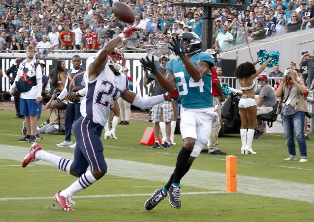 <p>Jacksonville Jaguars wide receiver Keelan Cole (84) makes a touchdown grab in front of New England Patriots defensive back Eric Rowe (25) during the first quarter at TIAA Bank Field. Mandatory Credit: Reinhold Matay-USA TODAY Sports </p>
