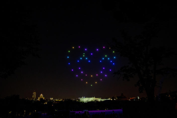 Drones display a heart to pay tribute to honor the victims of COVID-19 and sanitary workers in Madrid, Spain, Friday, June 26, 2020. Spain's cabinet will extend the furlough schemes adopted during the coronavirus lockdown that brought the economy to a standstill until the end of September. (AP Photo/Manu Fernandez)