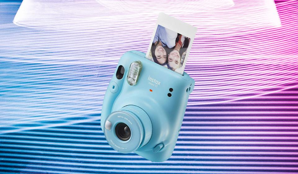 The Fujifilm Instax Max 11 is for impatient photographers: It cranks out a self-developing print right after you click the shutter. (Photo: Fujifilm)