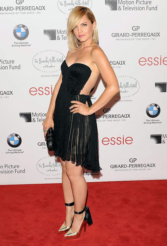 "On Saturday evening, Mena Suvari put a sexy spin on the little black dress when she showed up at the Motion Picture & Television Fund gala in a barely-there Maria Lucia Hohan cocktail frock. Surprisingly (and to the chagrin of the men in attendance), the alluring ""American Pie"" alum didn't deliver a wardrobe malfunction. Thanks to incredibly sheer paneling, hidden hardware, and perhaps a little bit of magic, the LBD simply produced an optical illusion. (6/16/2012)<br><br><a target=""_blank"" href=""http://twitter.com/YahooOmg"">Follow omg! on Twitter!</a>"