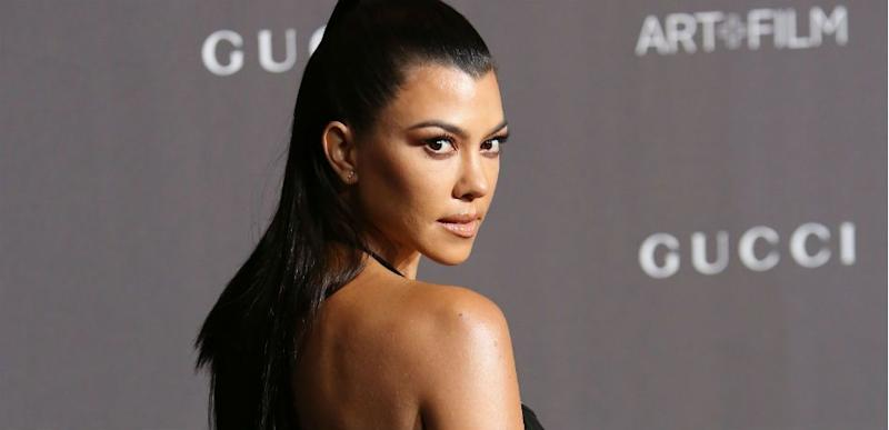 Kourtney Kardashian Does A Terrible Job Hiding Younes Bendjima In Seemingly-Naked New Year's Pic With Son Reign