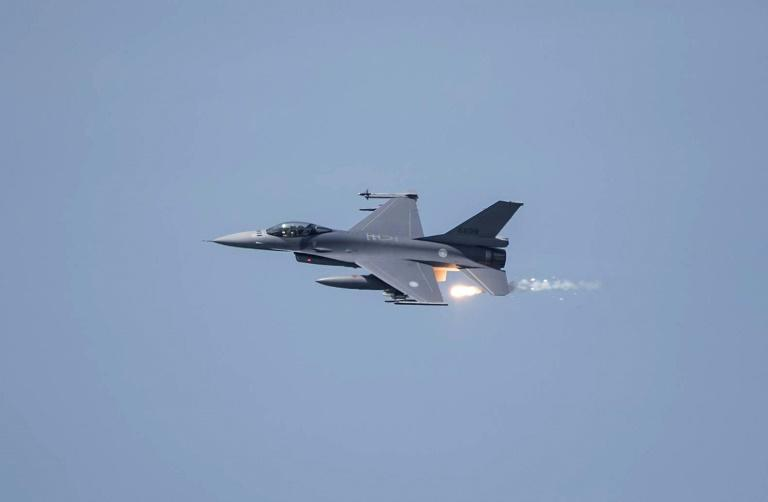 A US-made F-16V fighter releases flares during a Taiwan military drill. Taipei says the US sale of air-to-ground missiles will build its combat capabilities