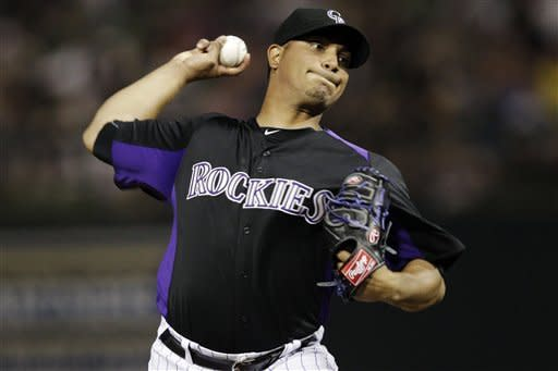 Colorado Rockies starting pitcher Jhoulys Chacin throws to the Texas Rangers during the second inning of a spring training baseball game, Friday, March 30, 2012, in Scottsdale, Ariz. (AP Photo/Marcio Jose Sanchez)