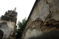 An earthquake cracked wall is seen beside a damaged turret, at the former San Guillermo Convent, where restoration work is underway three years after an earthquake damaged the church and adjacent cloisters, in Totolapan, Morelos state, Mexico, Tuesday, Oct. 13, 2020. Unable to correct inclinations in some structures, the best restoration work will still leave some buildings leaning at crazy angles, steadied with steel cables and counterweights. (AP Photo/Rebecca Blackwell)
