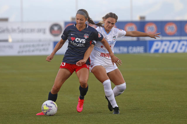 Chicago Red Stars' Bianca St. Georges, right, battles with Washington Spirit forward Ashley Hatch (33) during the first half of an NWSL Challenge Cup soccer match at Zions Bank Stadium, Saturday, June 27, 2020, in Herriman, Utah. (AP Photo/Rick Bowmer)