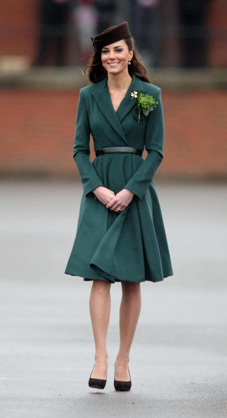 <p>For her first St Patrick's Day appearance, the Duchess wore an Emilia Wickstead green coat dress that instantly landed on every woman's wish-list. She teamed the jacket with a brown belt that cinched in her tiny waist and Jimmy Choo shoes. <em>[Photo: PA]</em> </p>