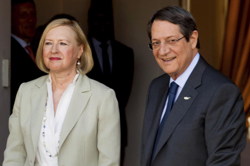 In this photo released from Cyprus' Press and Informations Office, Cyprus President Nicos Anastasiades, right, and UN Secretary General's Special Representative to Cyprus Elizabeth Spehar, before their talks with Turkish Cypriot leader Mustafa Akinci inside the UN buffer zone in divided capital Nicosia, Cyprus, Friday, Aug. 9, 2019.  The rival leaders of ethnically divided Cyprus are meeting to scope out whether there's enough common ground for a return to formal peace talks. (Stavros Ioannides/PIO via AP)