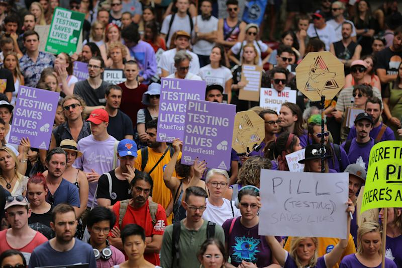 Protesters holding signs in support of pill testing are seen during the Reclaim The Streets Rally in central Sydney, Saturday, January 19, 2019. Source: AAP/Steven Saphore