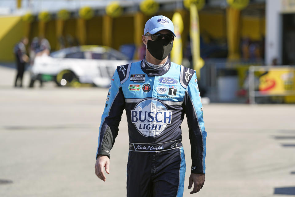 Kevin Harvick heads to his garage before a NASCAR Daytona 500 auto race practice session at Daytona International Speedway, Wednesday, Feb. 10, 2021, in Daytona Beach, Fla. (AP Photo/John Raoux)