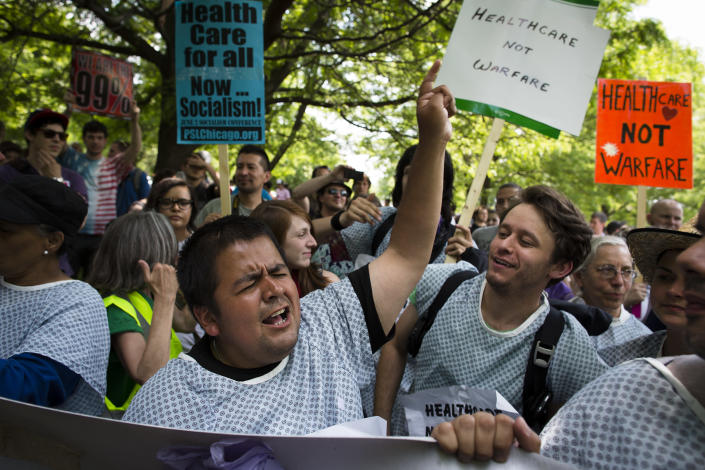 An anti-NATO demonstrator chants before a march on Chicago Mayor Rahm Emanuel's home, Saturday, May 19, 2012, in Chicago. On Sunday, the start of the two-day NATO summit, thousands of protesters are expected to march to the McCormick Place convention center, where NATO delegates will be meeting. (AP Photo/John Minchillo)