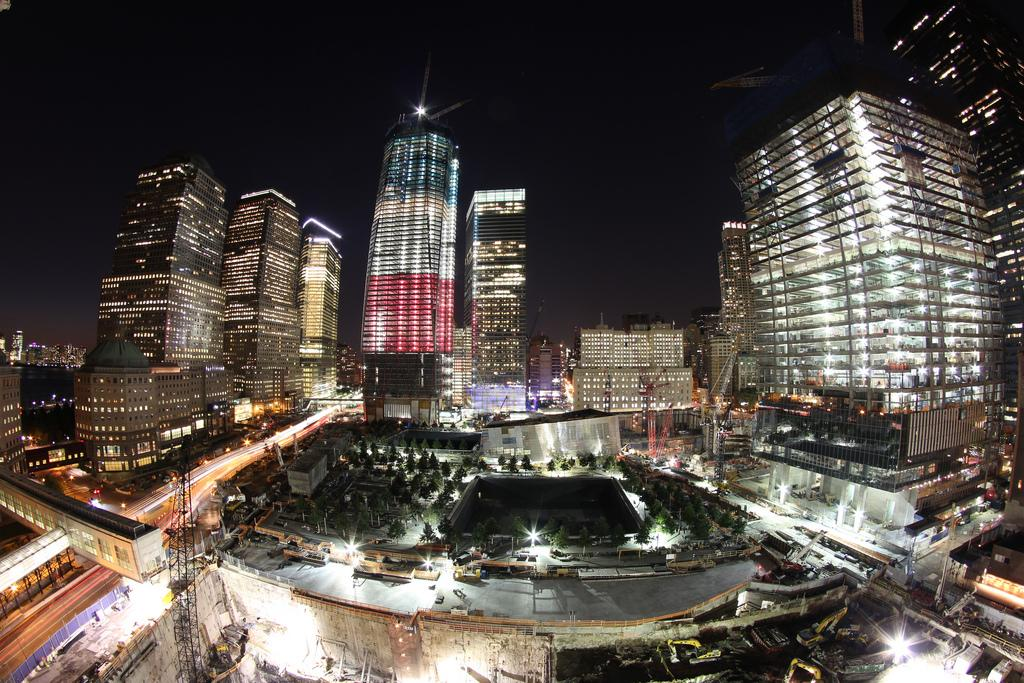 """Ground Zero at night.<br><br><span>By <a target=""""_blank"""" href=""""http://www.flickr.com/photos/60713648@N03/5897095502/sizes/l/in/pool-1775706@N22/"""">328DLCR</a></span>, Copyright © 2011"""
