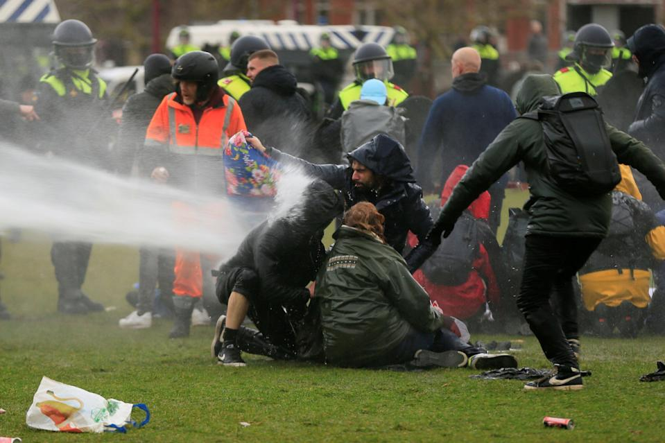 <p>Police use a water canon during a protest against restrictions put in place to curb the spread of the coronavirus in Amsterdam</p> (REUTERS)