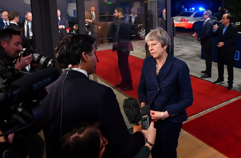 FILE PHOTO: British Prime Minister Theresa May talks to reporters as she arrives at the European Council to meet with European Council President Donald Tusk to discuss draft agreements on Brexit, in Brussels