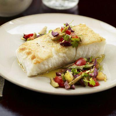 "<p>This Halibut dish may look like something you'd get at a nice restaurant, but it's actually super simple to make and takes less than 30 minutes.<br></p><p><em><a href=""https://www.womansday.com/food-recipes/food-drinks/recipes/a22253/halibut-tomato-olive-seafood-recipes/"" rel=""nofollow noopener"" target=""_blank"" data-ylk=""slk:Get the Halibut with Tomato, Olive, and Pine Nut Relish recipe."" class=""link rapid-noclick-resp""><strong>Get the Halibut with Tomato, Olive, and Pine Nut Relish recipe.</strong></a></em><br></p>"