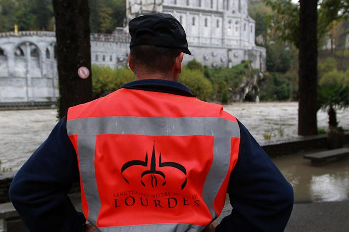 View of basilica of Immacule Conception on the sanctuary of Lourdes flooded, in Lourdes, southwestern France, Saturday, Oct. 20, 2012. French rescue services and police are evacuating hundreds of pilgrims from hotels threatened by floodwaters from a rain-swollen river in the Roman Catholic shrine town of Lourdes. (AP Photo/Bob Edme)