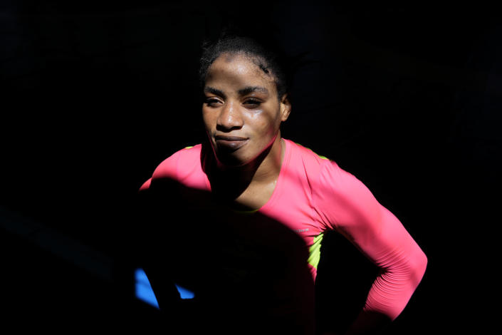 Guinean wrestler Fatoumata Yarie Camara poses for a portrait at the end of her morning training session at the Ostia's Olympic training center, near Rome, Monday, July 5, 2021. A West African wrestler's dream of competing in the Olympics has come down to a plane ticket. Fatoumata Yarie Camara is the only Guinean athlete to qualify for these Games. She was ready for Tokyo, but confusion over travel reigned for weeks. The 25-year-old and her family can't afford it. Guinean officials promised a ticket, but at the last minute announced a withdrawal from the Olympics over COVID-19 concerns. (AP Photo/Alessandra Tarantino)