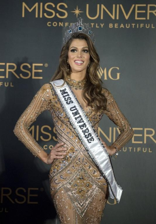 <p>The new Miss Universe Iris Mittenaere of France poses for photographers during a press conference after being crowned the winner at the Miss Universe pageant at the Mall of Asia Arena in Manila on January 30, 2017. France was crowned Miss Universe on January 30 in a glitzy spectacle free of last year's dramatic mix-up but with a dash of political controversy as finalists touched on migration and other hot-button global issues. / AFP PHOTO / NOEL CELIS </p>