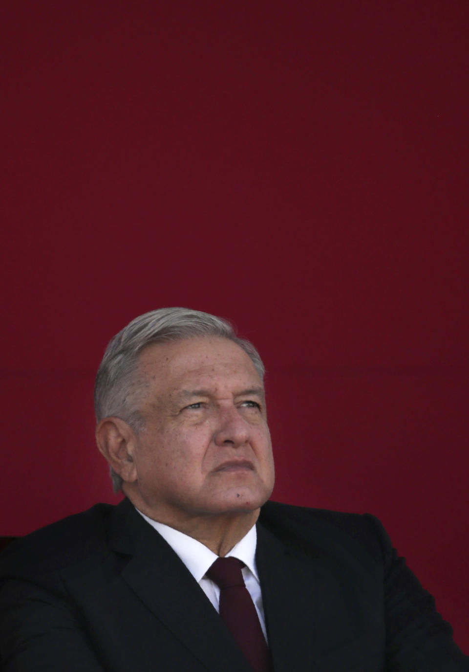 FILE - In this Feb. 9, 2021 file photo, Mexican President Andres Manuel Lopez Obrador attends a ceremony marking the 108th anniversary of the Marcha de la Lealtad or March of Loyalty, at Chapultepec Castle in Mexico City. López Obrador's support of a gubernatorial candidate accused of sexual assaults has opened a rift in the party he founded. The president has dismissed the allegations as a political attack on the candidate and himself. (AP Photo/Marco Ugarte, File)