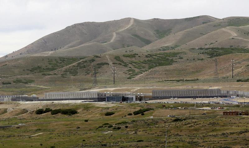 This Monday, June 10, 2013 photo shows the National Security Agency's Utah Data Center in Bluffdale, Utah. The Obama administration says it has no plans to end a broad U.S. spy program that it says is keeping America safe from terrorists. That comes as the White House faces fresh anger at home and from abroad over its secretive surveillance system that tracks phone and Internet messages around the world. (AP Photo/Rick Bowmer)