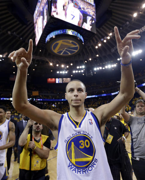 Golden State Warriors' Stephen Curry celebrates after a 92-88 win over the Denver Nuggets during Game 6 in a first-round NBA basketball playoff series in Oakland, Calif., Thursday, May 2, 2013. (AP Photo/Marcio Jose Sanchez)