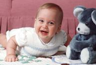 <p>William, 8 months, shows off his new teeth during playtime at Kensington Palace. </p>