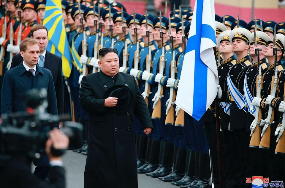 Kim attends a welcoming ceremony in Vladivostok after his arrival (AP)