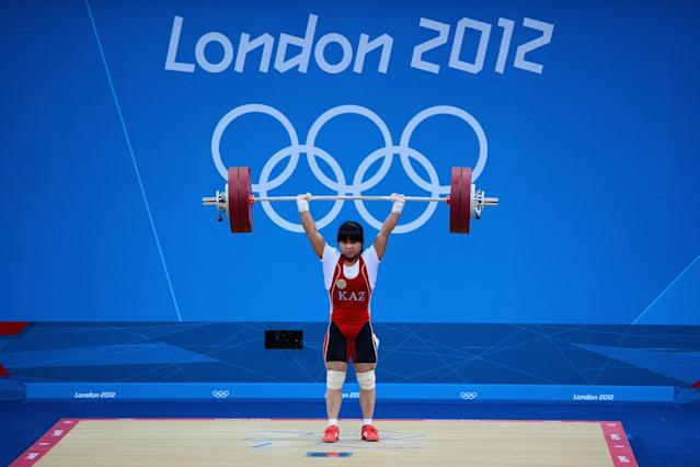 LONDON, ENGLAND - JULY 29: Zulfiya Chinshanlo of Kazakhstan sets a world and Olympic record as she competes in the Women's 53kg Weightlifting on Day 2 of the London 2012 Olympic Games at ExCeL on July 29, 2012 in London, England. (Photo by Laurence Griffiths/Getty Images)