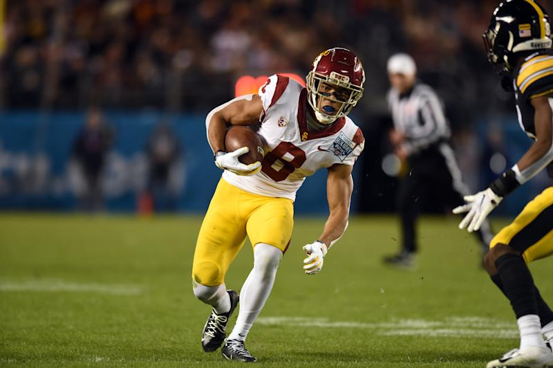 SAN DIEGO, CA - DECEMBER 27: USC Trojans wide receiver Amon-Ra St. Brown (8) runs the ball during the Holiday Bowl game between the USC Trojans and the Iowa Hawkeyes on December 27, 2019, at SDCCU Stadium in San Diego, CA. (Photo by Chris Williams/Icon Sportswire via Getty Images)