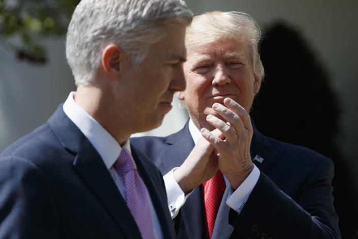 President Donald Trump applauds new Supreme Court Justice Neil Gorsuch during a public swearing-in ceremony for Gorsuch in the Rose Garden of the White House in Washington on April 10, 2017. (Photo: Evan Vucci/AP)