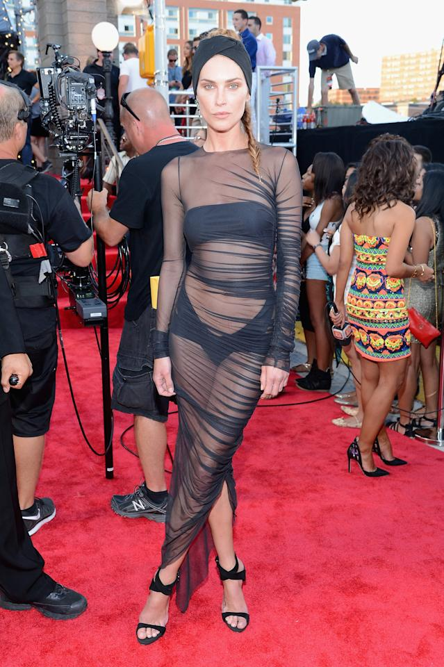 <p>Erin Wasson was not shy to put her figure - and daring style - on display in a sheer black dress as she stepped onto the VMAs red carpet in 2013. She completed her look with a turban-inspired headband and black strappy sandals. </p>