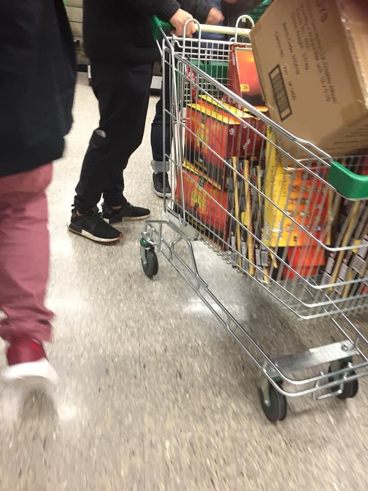 A customer with a trolley full of Lion King collectables at a Woolworths store in Adelaide.