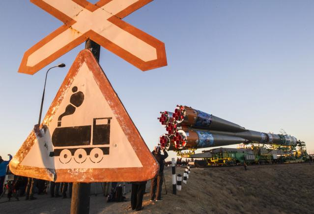 The Soyuz TMA-11M spacecraft decorated with 2014 Sochi Winter Olympic Games' patterns is transported to its launch pad at the Baikonur cosmodrome November 5, 2013. The Soyuz spacecraft will carry Japanese astronaut Koichi Wakata, Russian cosmonaut Mikhail Tyurin and U.S. astronaut Rick Mastracchio to the International Space Station (ISS) on November 7. REUTERS/Shamil Zhumatov (KAZAKHSTAN - Tags: SCIENCE TECHNOLOGY SOCIETY SPORT OLYMPICS)