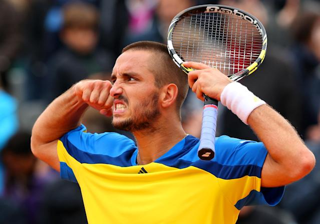 PARIS, FRANCE - MAY 31: Viktor Troicki of Serbia celebrates match point during his Men's Singles match against Marin Cilic of Croatia on day six of the French Open at Roland Garros on May 31, 2013 in Paris, France. (Photo by Julian Finney/Getty Images)