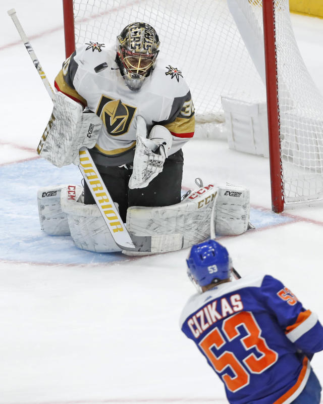 A shot by New York Islanders center Casey Cizikas (53) bounces near the chin of Vegas Golden Knights goaltender Malcolm Subban (30) during the third period of an NHL hockey game, Thursday, Dec. 5, 2019, in Uniondale, N.Y. (AP Photo/Kathy Willens)