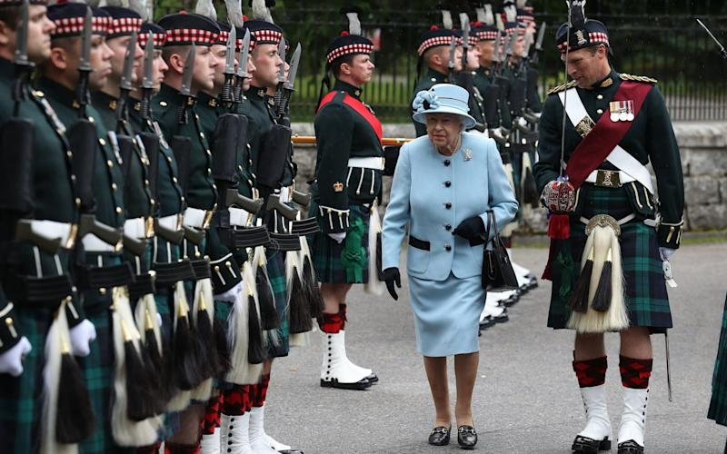 The Queen inspects a Royal Regiment at the gates of Balmoral ahead of taking up summer residence at the castle. - PA