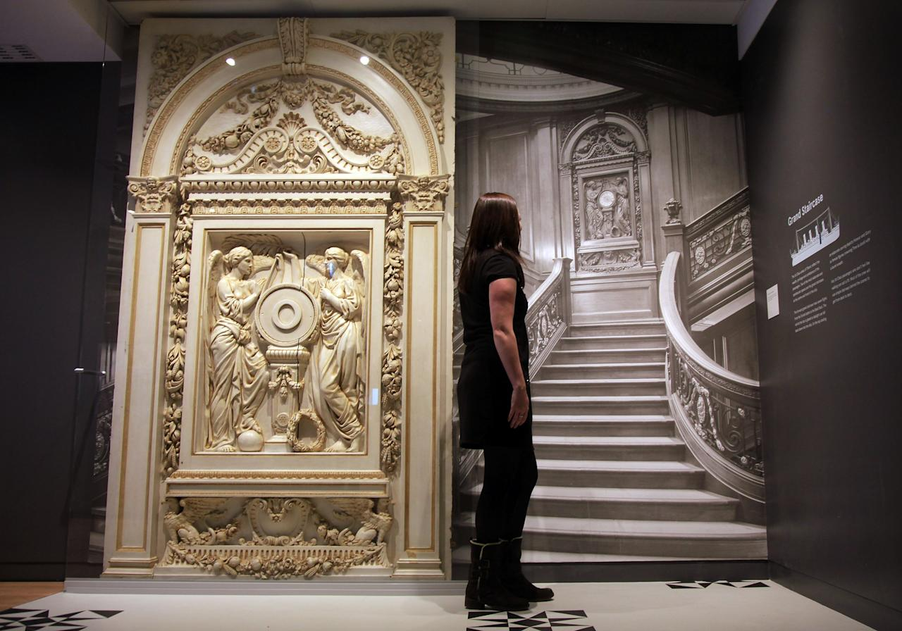 A visitor looks at a picture of the grand staircase at the museum's Titanic exhibition on April 3, 2012 in Southampton, England. The new SeaCity Museum, which will open at 1.30pm on April 10, 100 years to the day since the Titanic set sail from the city. The museum, which cost 15 GBP million, promises to tell the largely untold story of Southampton's Titanic crew and the impact the tragedy had on the city, as well as featuring other aspects of the city's seafaring past.  (Photo by Matt Cardy/Getty Images)