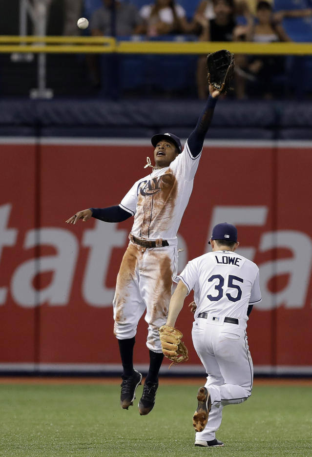Tampa Bay Rays center fielder Mallex Smith and shortstop Brandon Lowe (35) can't get a double by Cleveland Indians' Jose Ramirez during the fifth inning of a baseball game Monday, Sept. 10, 2018, in St. Petersburg, Fla. (AP Photo/Chris O'Meara)