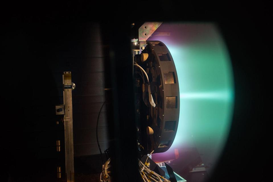A side shot of the X3 ion thruster firing at 50 kilowatts. <cite>NASA</cite>
